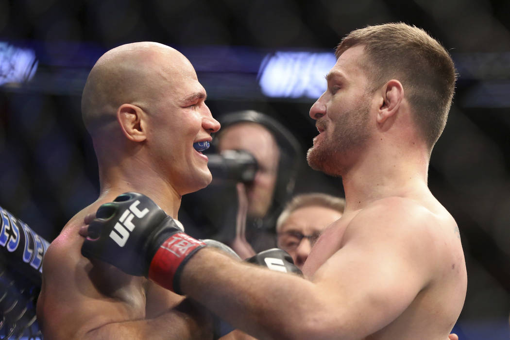 Stipe Miocic, right, hugs Junior Dos Santos after their mixed martial arts bout at UFC 211 for the UFC heavyweight championship, Saturday, May 13, 2017, in Dallas. Miocic retained his heavyweight  ...