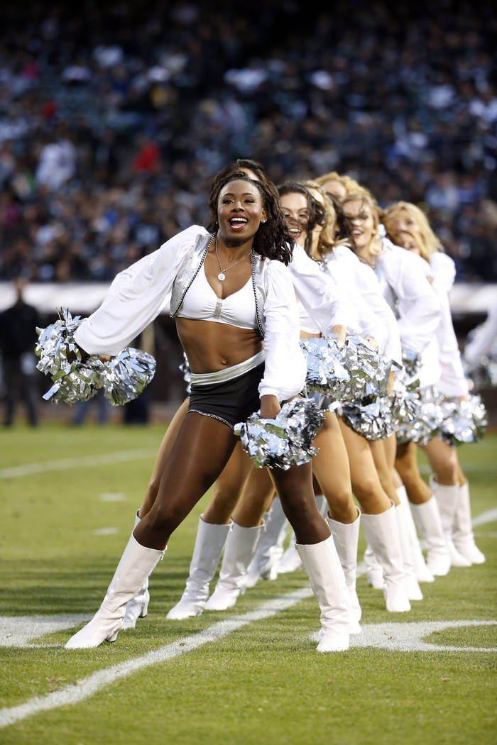 Cheerleaders perform during the first half of a preseason NFL football game between the Oakland Raiders and the Seattle Seahawks Thursday, Sept. 1, 2016, in Oakland, Calif. (AP Photo/Tony Avelar)
