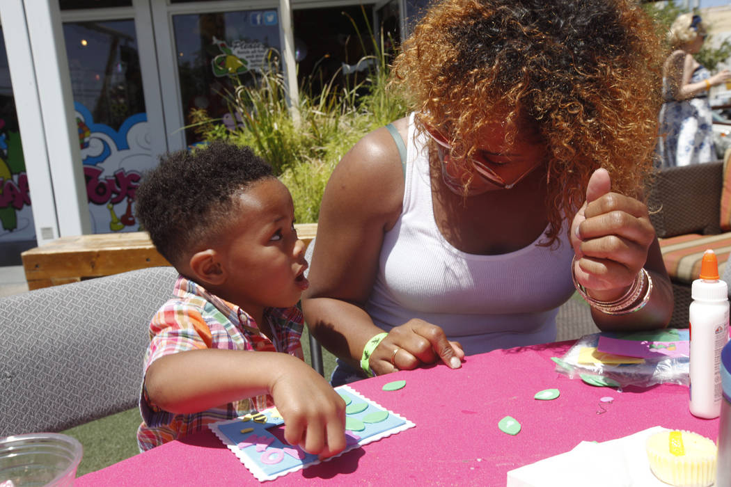 Brittain Cosey, 3, talks to his mom Jahvin Cosey, at the Container Park Mother's Day brunch on Sunday, May 14, 2017, in Las Vegas. Rachel Aston Las Vegas Review-Journal @rookie__rae