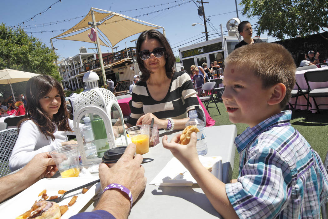 Athena Moore, 9, and Apollo Moore, 5, eat brunch with their mom Nancy Moore at the Container Park Mother's Day brunch on Sunday, May 14, 2017, in Las Vegas. Rachel Aston Las Vegas Review-Journal @ ...