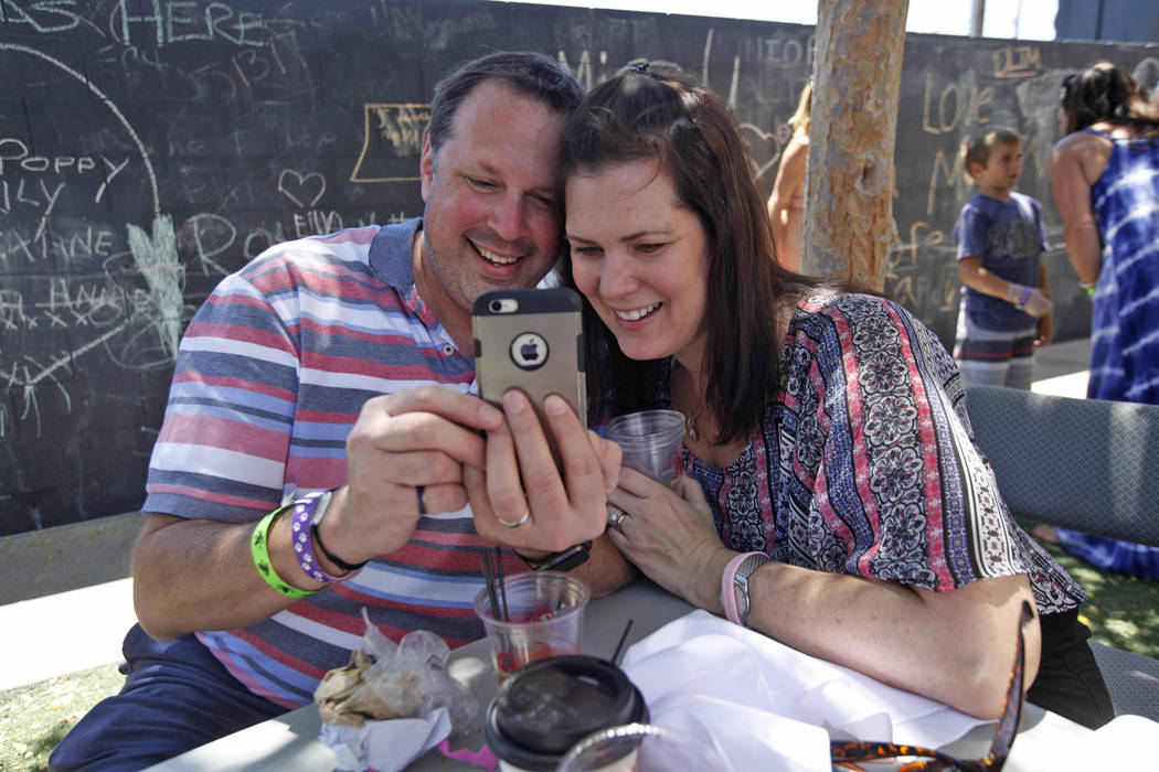 Brian Smith and his wife Suzanne Smith talk to his mom via FaceTime at the Container Park Mother's Day brunch on Sunday, May 14, 2017, in Las Vegas. Rachel Aston Las Vegas Review-Journal @rookie__rae