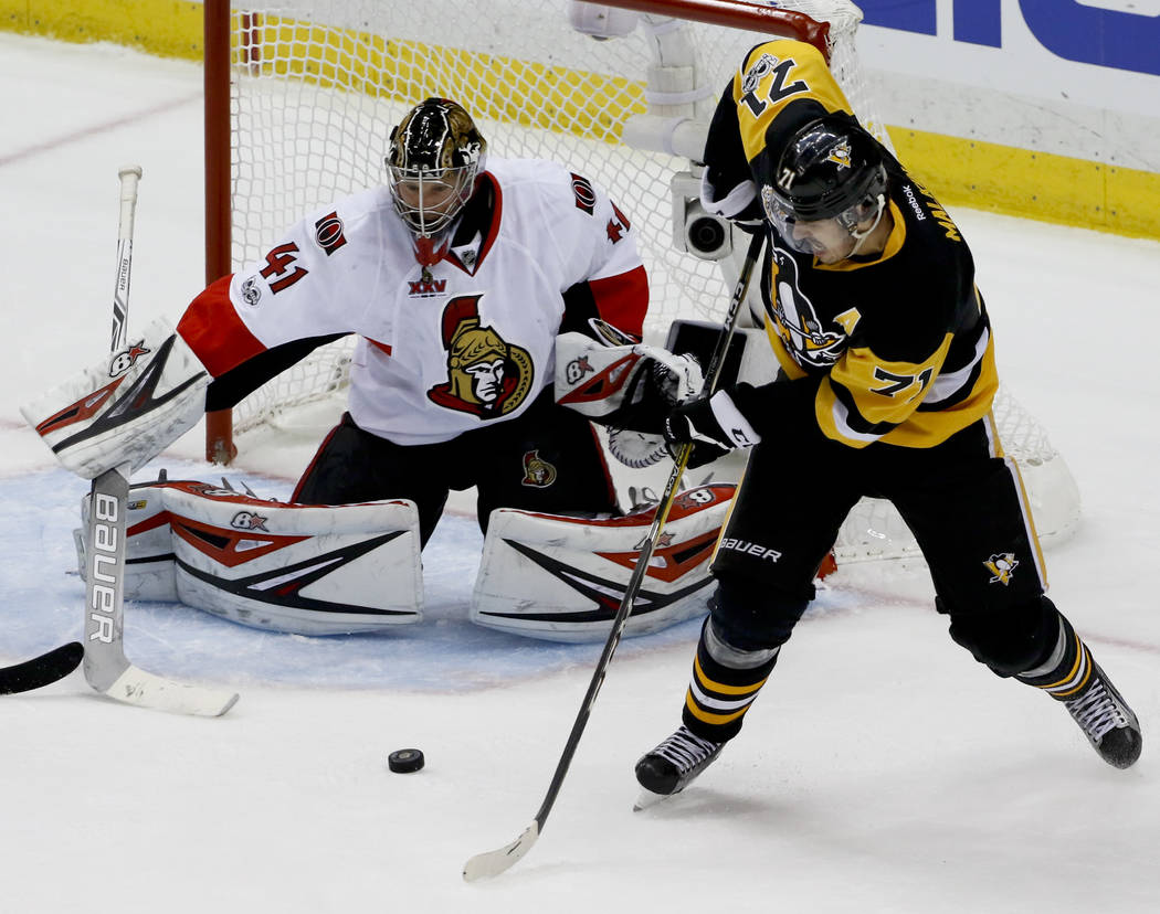 Pittsburgh Penguins' Evgeni Malkin (71) shoots and scores on Ottawa Senators goalie Craig Anderson (41) during the third period of Game 1 of the Eastern Conference final in the NHL hockey Stanley  ...