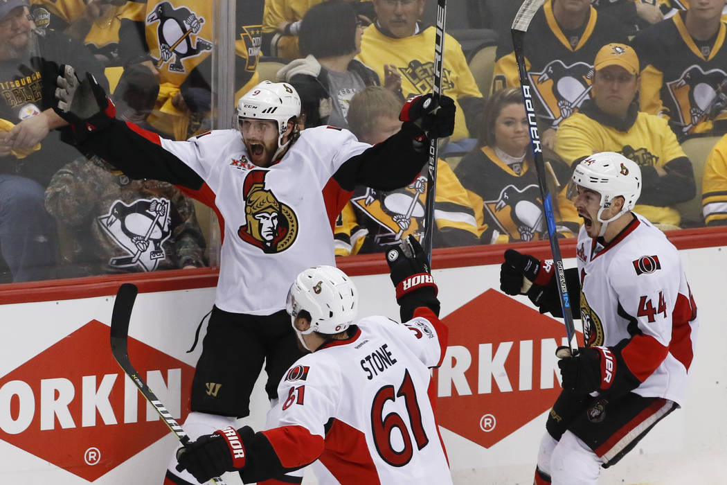 Ottawa Senators' Bobby Ryan, left, celebrates with teammates Mark Stone (61) and Jean-Gabriel Pageau (44) after scoring the game-winning goal against the Pittsburgh Penguins during the overtime pe ...