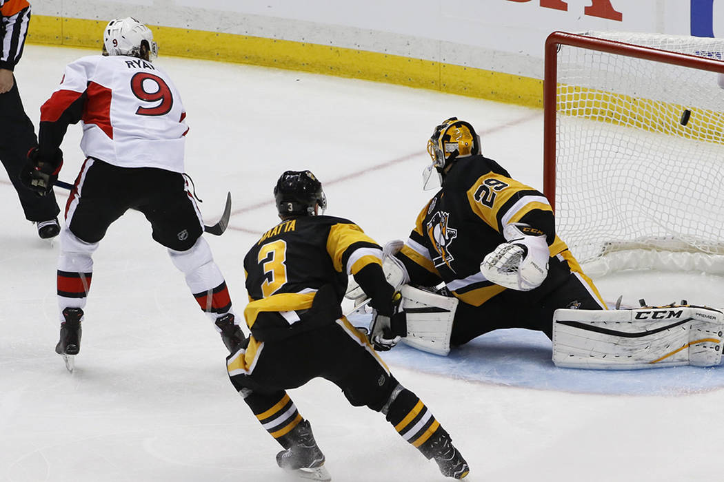 Ottawa Senators' Bobby Ryan (9) scores [ast Pittsburgh Penguins goalie Marc-Andre Fleury (29) after getting by Olli Maatta (3) during the overtime period of Game 1 of the Eastern Conference final  ...