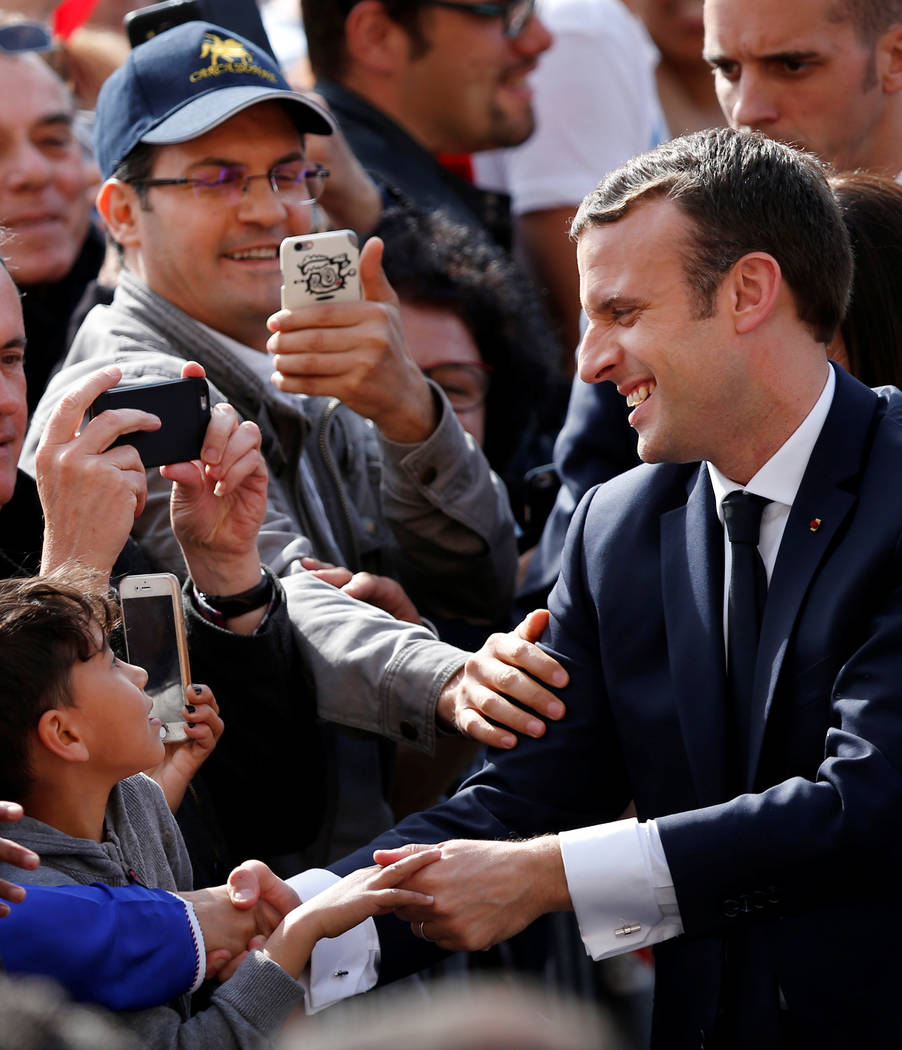 French President Emmanuel Macron (R), greets people in the crowd outside the Hotel de Ville in Paris, France, May 14, 2017. (Francois Lenoir/Reuters)