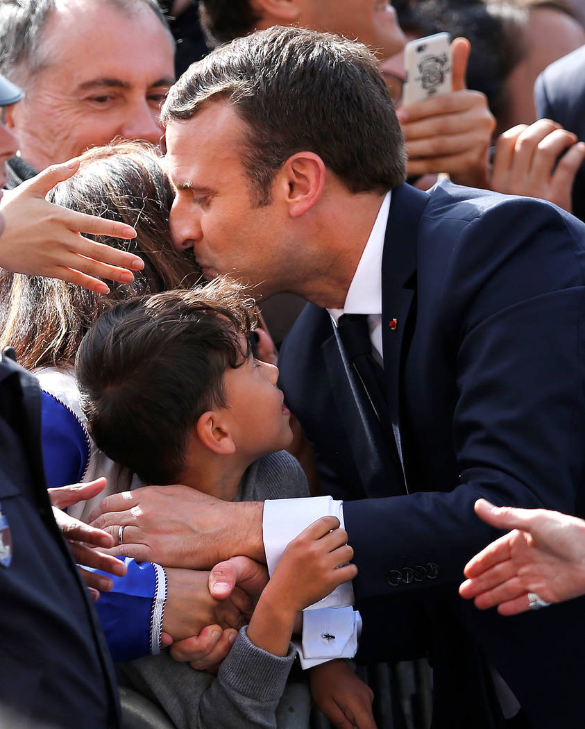 French President Emmanuel Macron, greets people in the crowd outside the Hotel de Ville in Paris, France, May 14, 2017.   REUTERS/Francois Lenoir