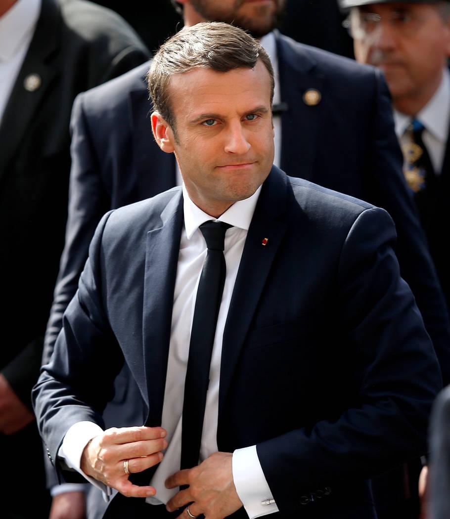 French President Emmanuel Macron buttons his jacket outside the Hotel de Ville in Paris, France, May 14, 2017. (Francois Lenoir/Reuters)