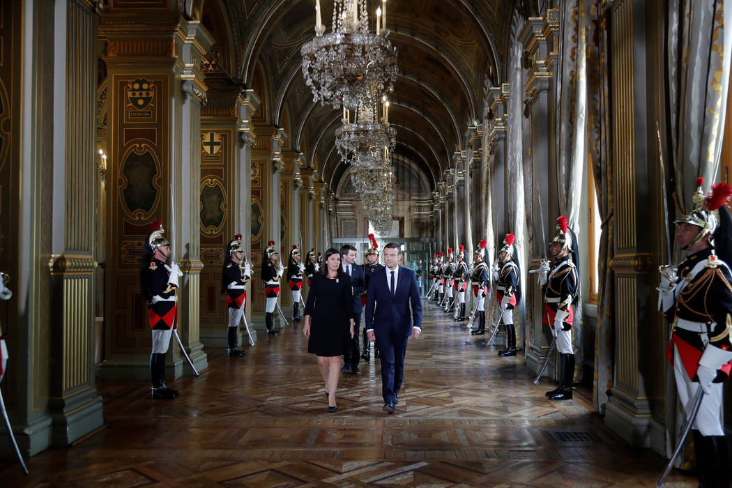 French President Emmanuel Macron and Paris Mayor Anne Hidalgo walk together to attend a ceremony at the Hotel de Ville in Paris, France, May 14, 2017. (Charles Platiau/Reuters)