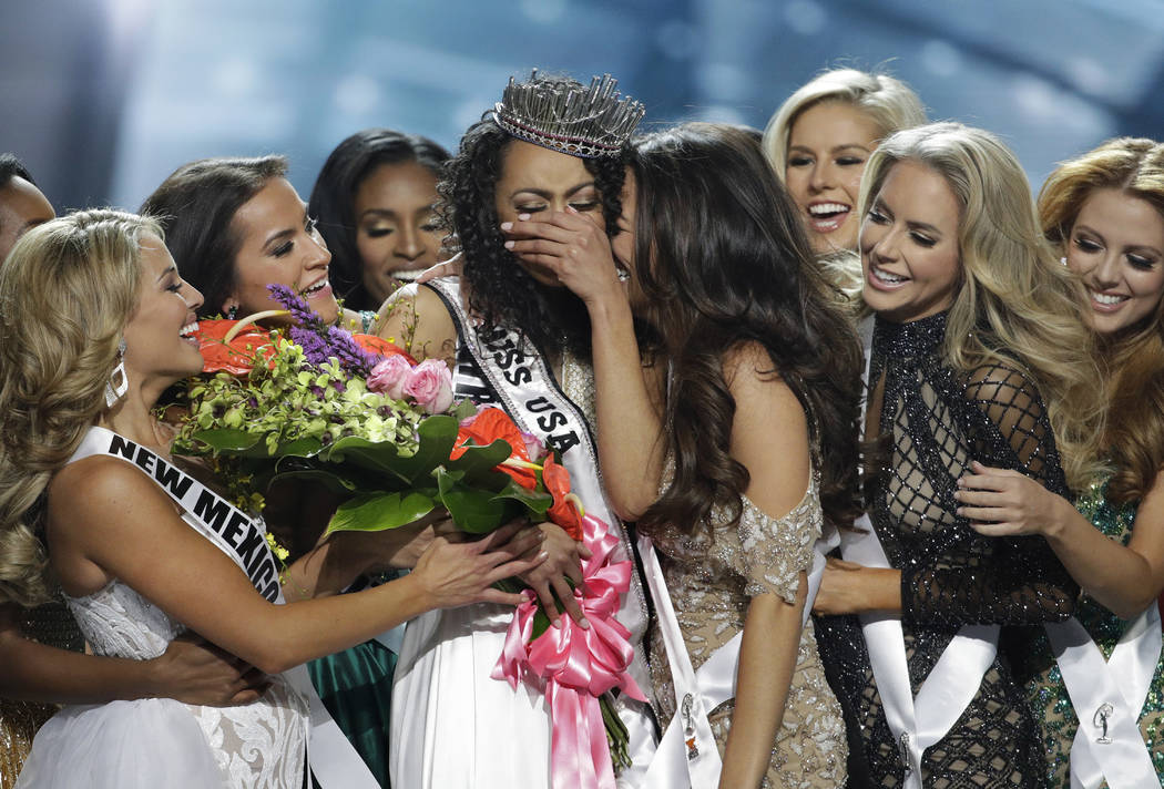 Miss District of Columbia USA Kara McCullough, center, reacts with fellow contestants after she was crowned the new Miss USA during the Miss USA contest Sunday, May 14, 2017, in Las Vegas. (AP Pho ...