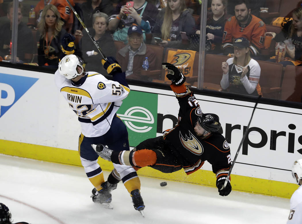 Nashville Predators' Matt Irwin (52) collides with Anaheim Ducks' Chris Wagner (21) as they battle for the puck during the second period of Game 2 of the Western Conference final in the NHL hockey ...