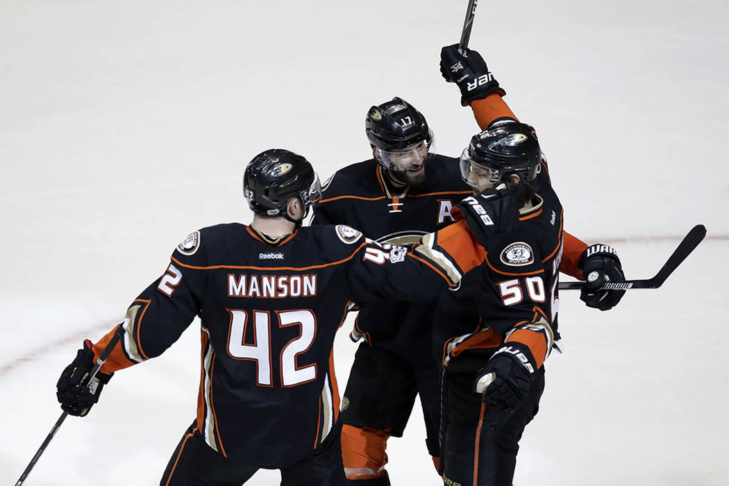 Anaheim Ducks' Antoine Vermette (50) celebrates with Josh Manson (42) and Ryan Kesler (17) after scoring a goal against the Nashville Predators during the third period of Game 2 of the Western Con ...