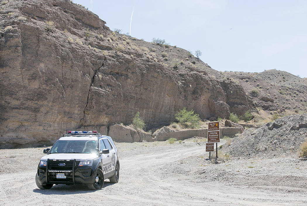 Metro officers block an entrance to Eagle Wash Road, that leads to the crime scene, at Lake Mead National Recreation Area on Tuesday, May 2, 2017. Bridget Bennett Las Vegas Review-Journal @bridget ...