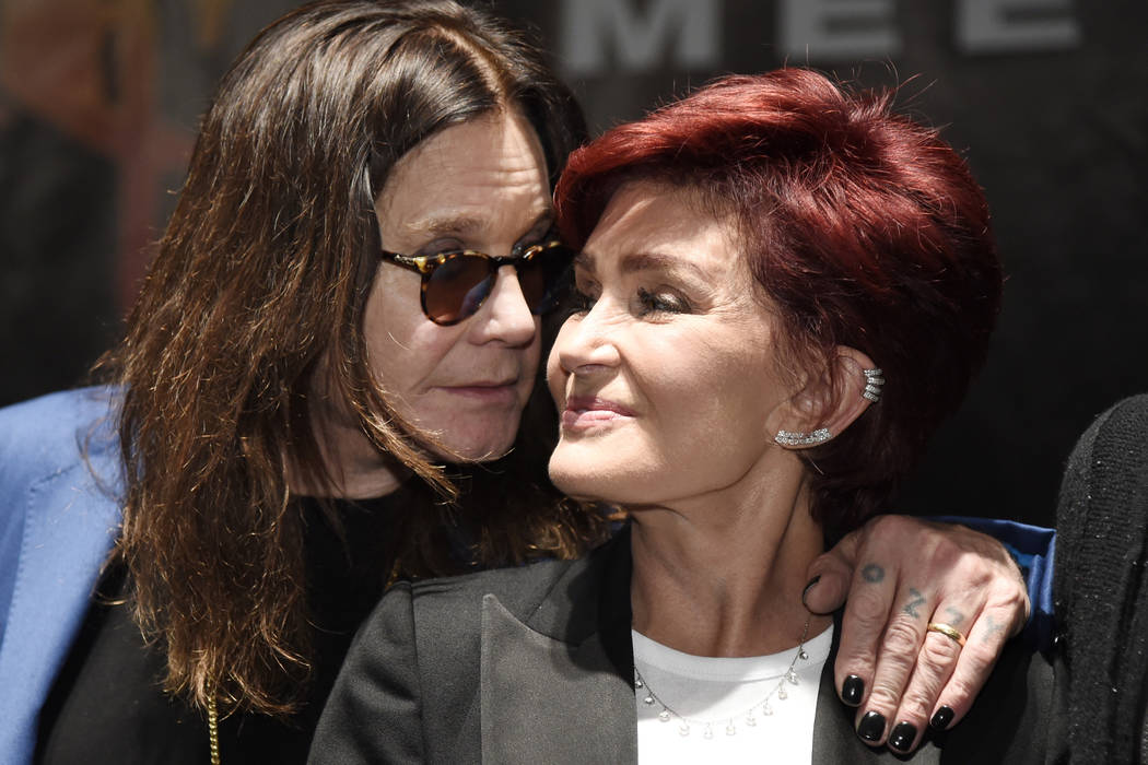 "Ozzy Osbourne, left, joins his wife Sharon onstage during the ""Ozzfest Meets Knotfest"" news conference at the Hollywood Palladium on Thursday, May 12, 2016, in Los Angeles. (Chris Pizzello/Invisio ..."