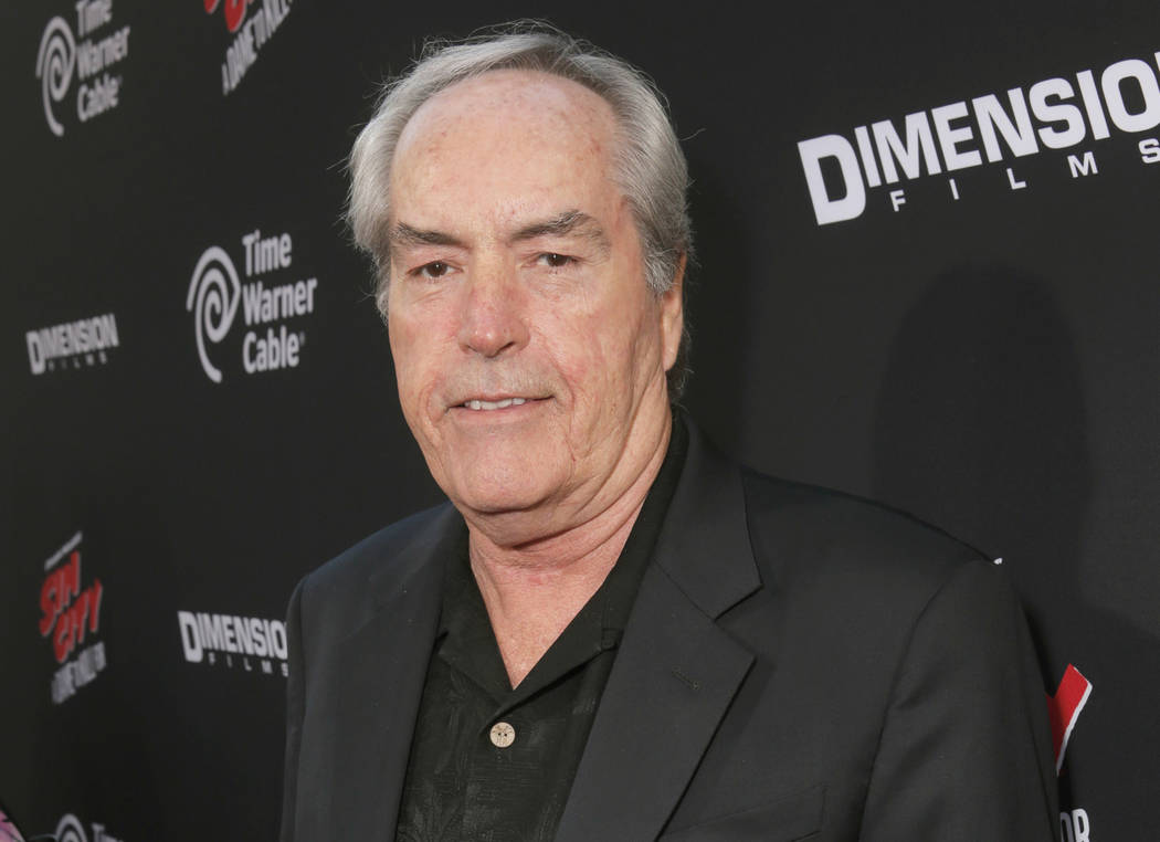 """Actor Powers Boothe attends the Los Angeles premiere of """"Sin City: A Dame To Kill For"""" in Los Angeles, Aug. 19, 2014. Boothe died Sunday, May 14, 2017. He was 68. (Todd Williamson/Invision/AP)"""