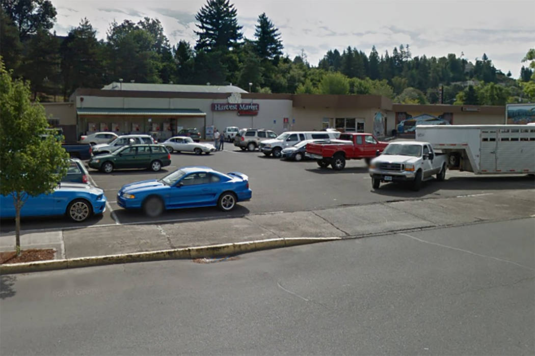 Police say a man carrying what appeared to be a human head stabbed an employee at this Oregon grocery store. (Google StreetView)