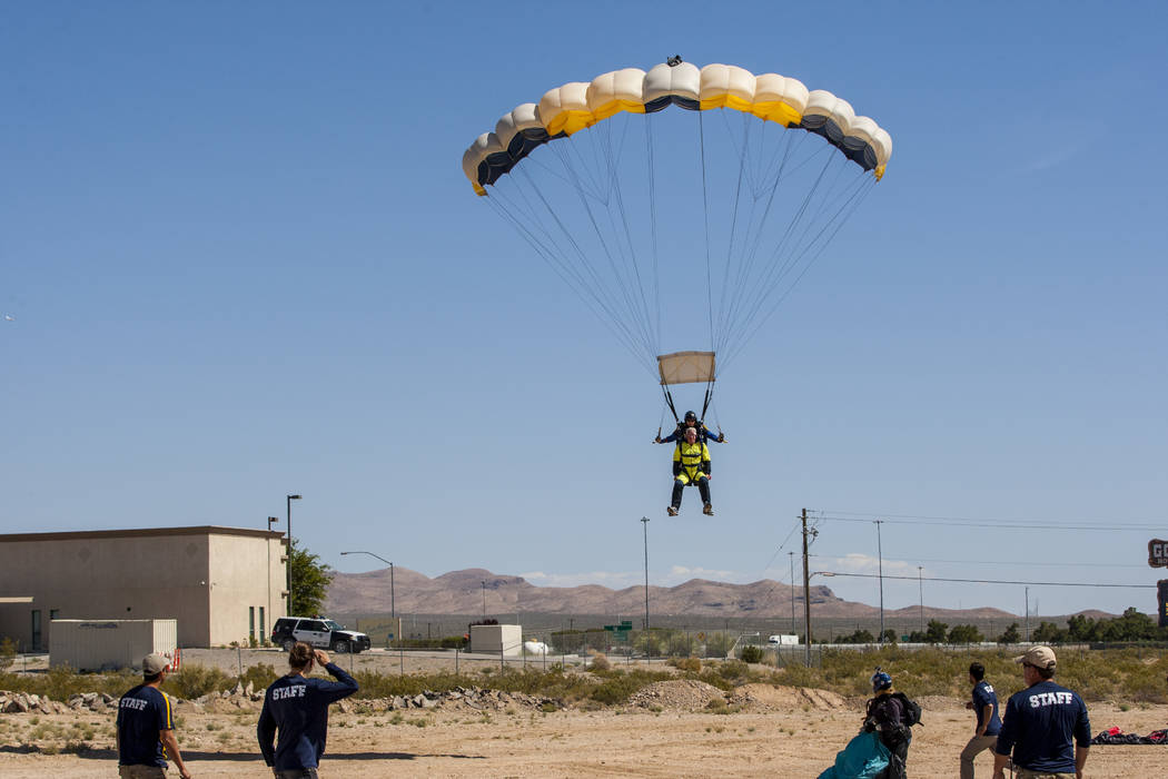 Bill McCrane, who just turned 60, prepares to land with Vegas Extreme Skydiving instructor John Fulk at the Jean Sport Aviation Center in Jean on Tuesday, May 16, 2017. Patrick Connolly Las Vegas  ...