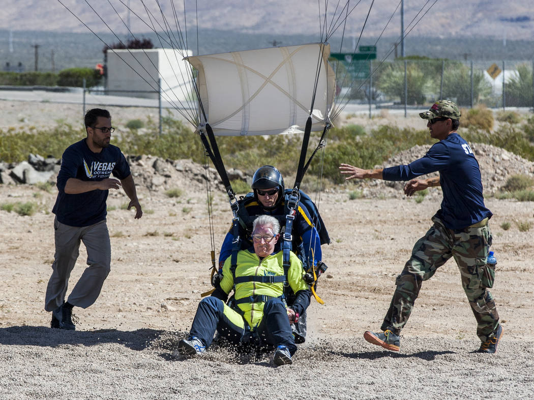 Bill McCrane, who just turned 60, lands after skydiving with Vegas Extreme Skydiving instructor John Fulk at the Jean Sport Aviation Center in Jean on Tuesday, May 16, 2017. Patrick Connolly Las V ...