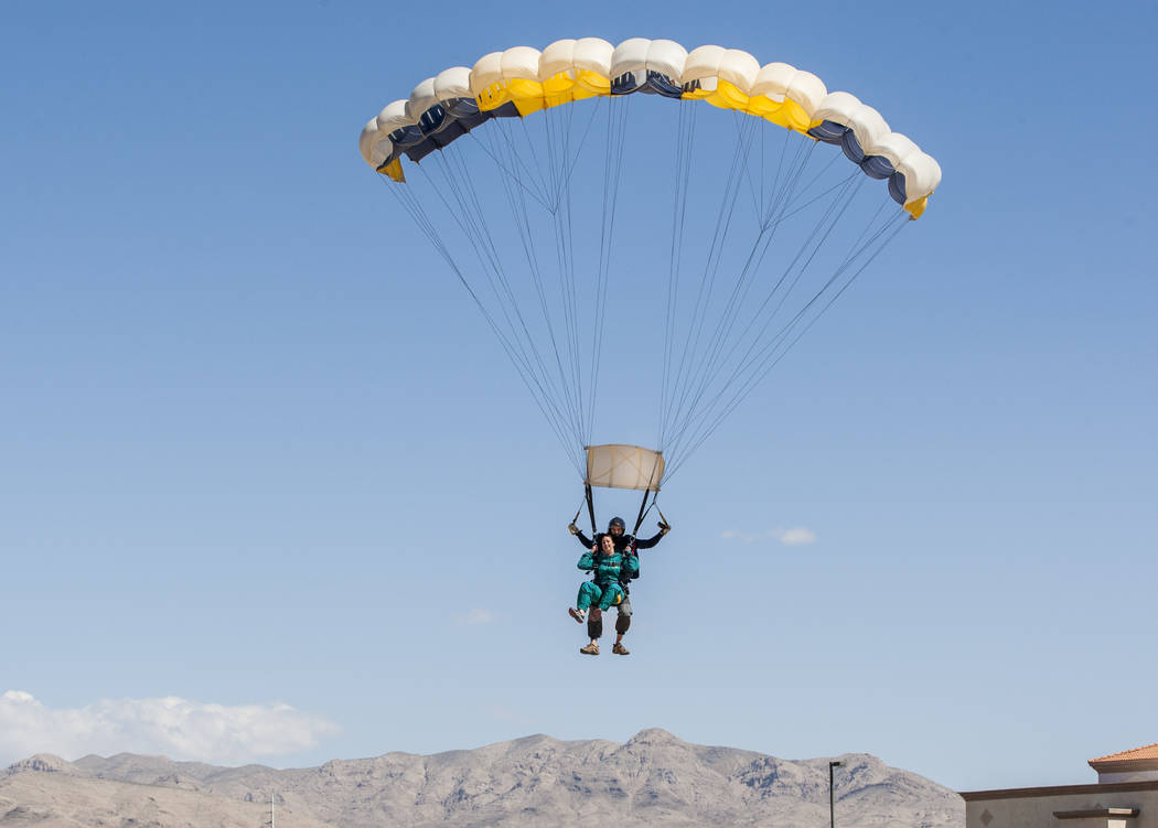 Jessica McCrane prepares to land with Vegas Extreme Skydiving instructor David Wessels at the Jean Sport Aviation Center in Jean on Tuesday, May 16, 2017. Patrick Connolly Las Vegas Review-Journal ...