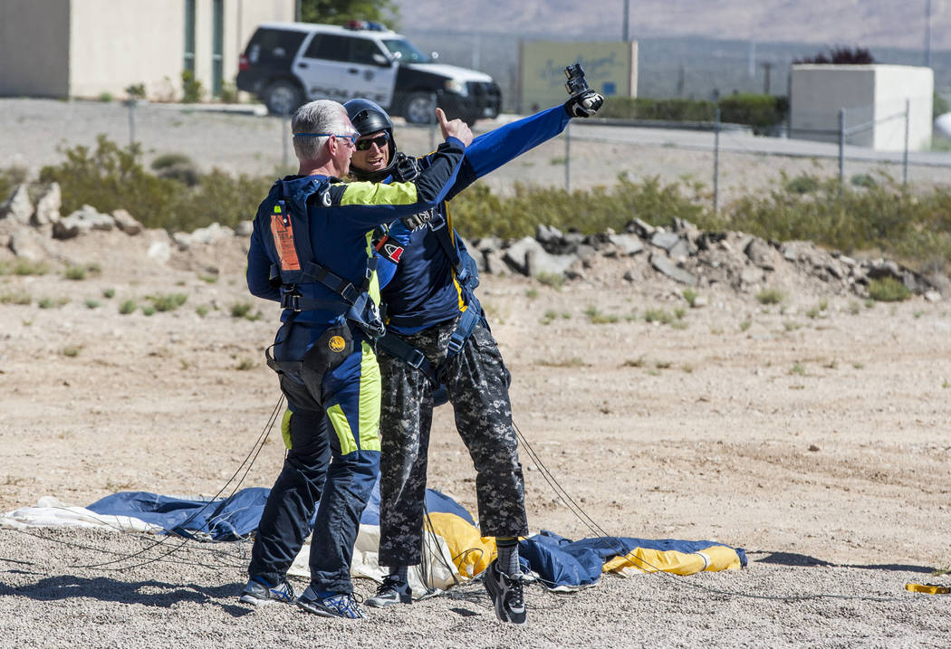 Bill McCrane, who just turned 60, films some post-dive footage with Vegas Extreme Skydiving instructor John Fulk at the Jean Sport Aviation Center in Jean on Tuesday, May 16, 2017. Patrick Connoll ...