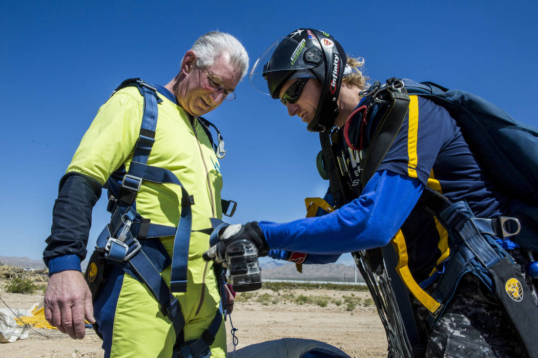 Bill McCrane, who just turned 60, has his harness loosened after skydiving with Vegas Extreme Skydiving instructor John Fulk at the Jean Sport Aviation Center in Jean on Tuesday, May 16, 2017. Pat ...
