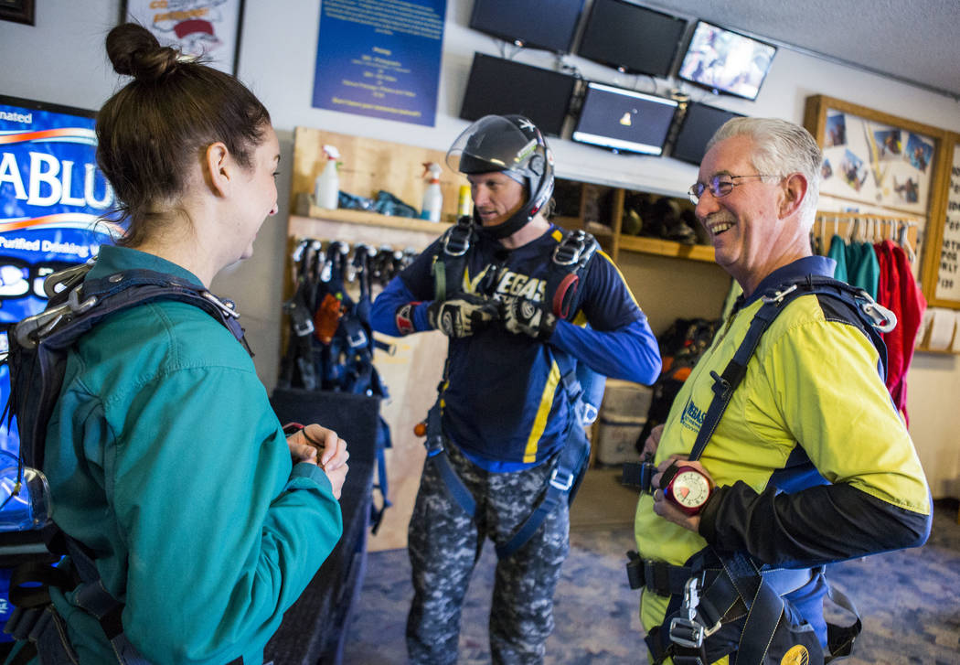 Bill McCrane, who just turned 60, shares a moment with his daughter, Jessica, before skydiving with Vegas Extreme Skydiving at the Jean Sport Aviation Center in Jean on Tuesday, May 16, 2017. Patr ...