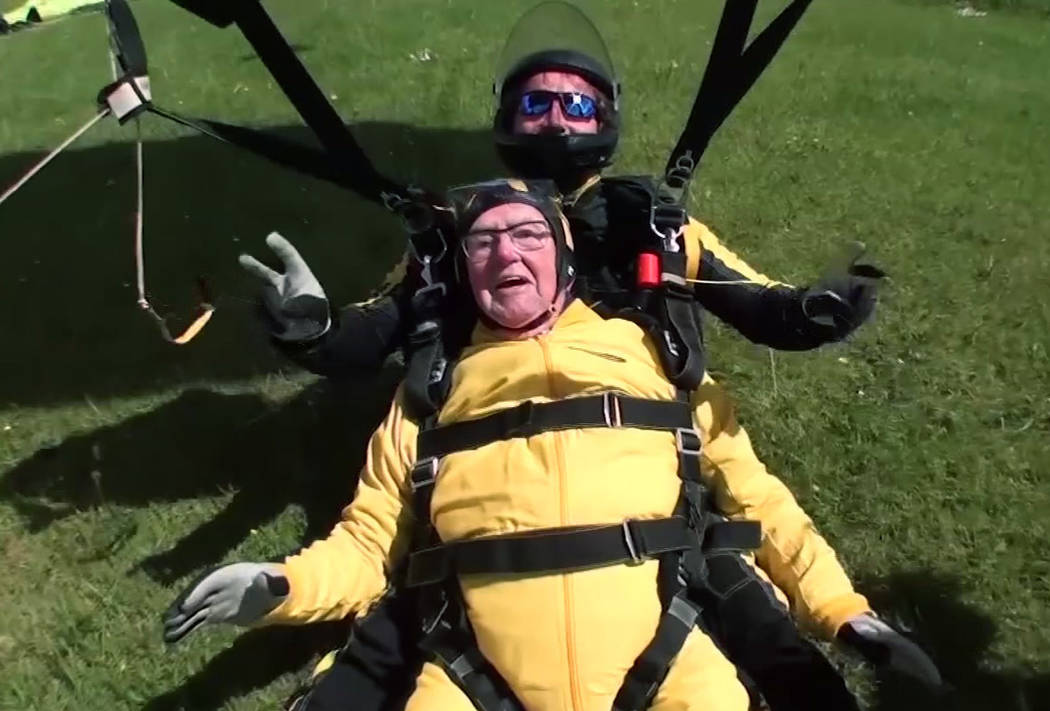 In this grab taken from video, Verdun Hayes lands after a tandem skydive, in Devon, England, Sunday, May 14, 2017. (Skydive.buzz via AP)