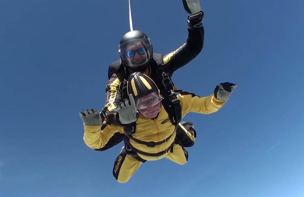 In this grab taken from video, Verdun Hayes gestures as he tandem skydiving, in Devon, England, Sunday, May 14, 2017. A 101-year-old D-Day veteran has broken the world record for the oldest tandem ...
