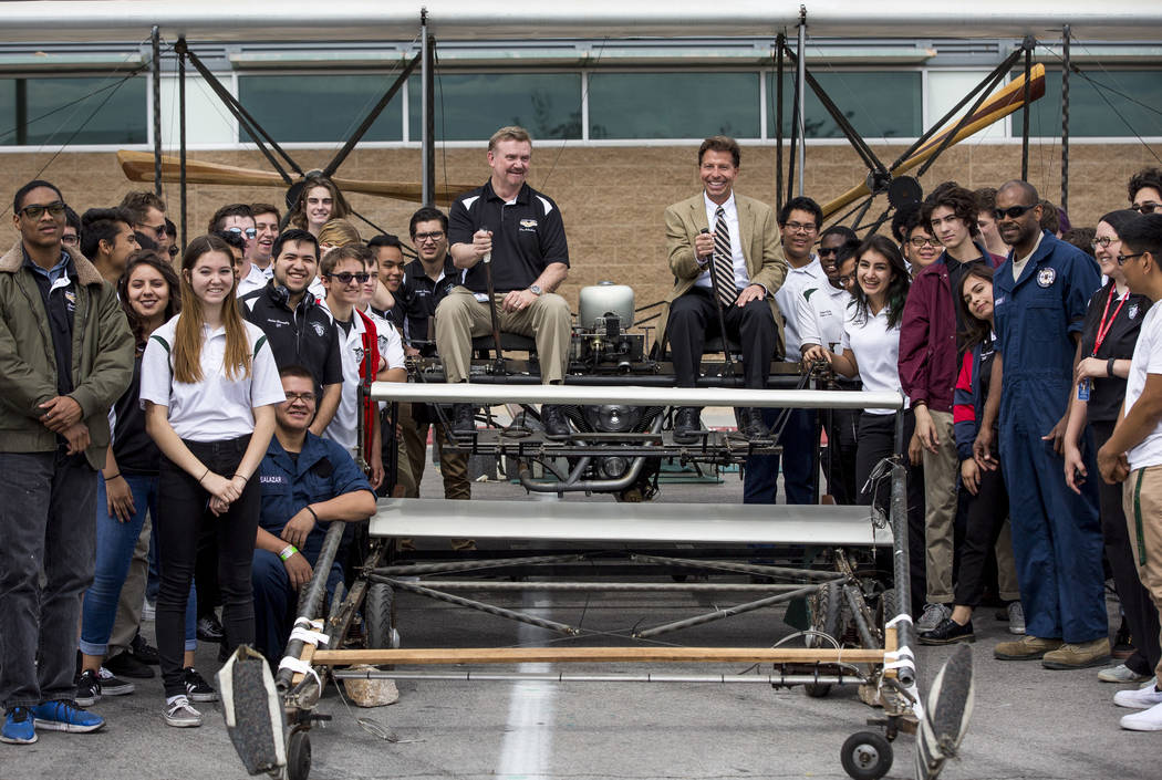 Rancho Principal Dr. James Kuzma, center right, aviation instructor Gary Archambaudt, center left, and aviation students gather around a full-size replica of the 1905 Wright Brothers Flyer at Ranc ...