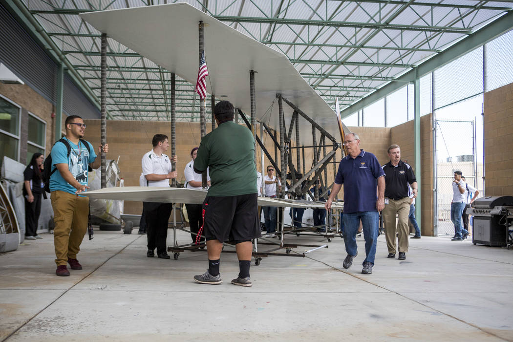 Aviation students and instructors transport the wings of a full-size replica of the 1905 Wright Brothers Flyer at Rancho High School in Las Vegas on Monday, May 15, 2017. The model, originally des ...