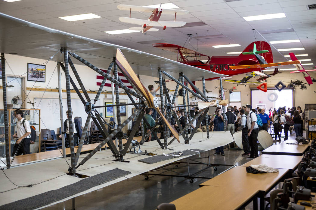 Aviation students gather around the wings of a full-size replica of the 1905 Wright Brothers Flyer at Rancho High School in Las Vegas on Monday, May 15, 2017. The model originally was designed and ...