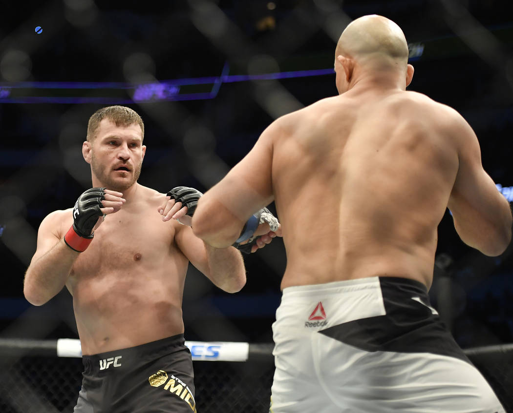 May 13, 2017; Dallas, TX, USA;  Stipe Miocic (red gloves) fights Junior Dos Santos (blue gloves) during UFC 211 at American Airlines Center. (Jerome Miron/USA Today Sports)