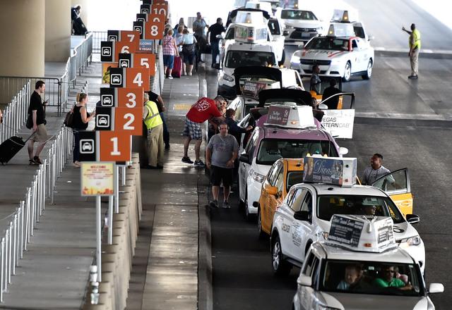 Taxi cabs line up for their passengers at Terminal 3 at McCarran International Airport Wednesday, Sept. 21, 2016, in Las Vegas. David Becker/Las Vegas Review-Journal Follow @davidjaybecker