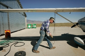 Dean Baker readies his plane for an aerial tour of his ranch in Snake Valley in October 2006. (Las Vegas Review-Journal)