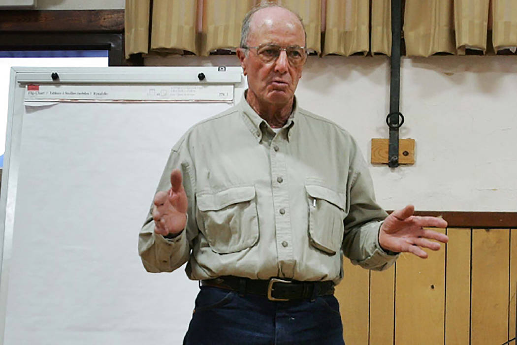 Rancher Dean Baker talks strategy with fellow Snake Valley residents at a 2009 meeting in advance of a hearing on plans to pipe groundwater to Las Vegas from across eastern Nevada. (Las Vegas Revi ...
