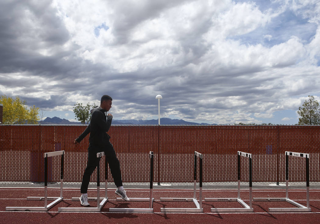 Legacy's Jamaal Britt warms up with hurdles at his school in Las Vegas on Wednesday, May 17, 2017. Chase Stevens Las Vegas Review-Journal @csstevensphoto