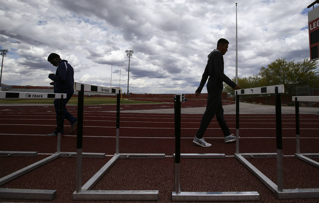 Legacy's Jamaal Britt, right, warms up with hurdles at his school in Las Vegas on Wednesday, May 17, 2017. Chase Stevens Las Vegas Review-Journal @csstevensphoto