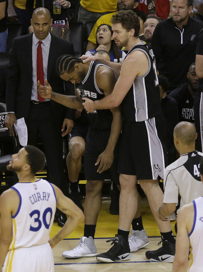 San Antonio Spurs forward Kawhi Leonard, center left, gestures next to center Pau Gasol during the second half of Game 1 of the NBA basketball Western Conference finals against the Golden State Wa ...