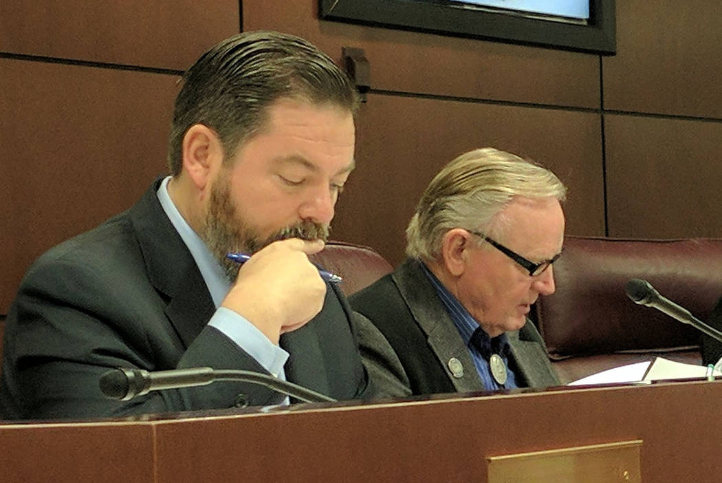 State senators Michael Roberson, left, and Don Gustavson, read a bill during a judiciary committee hearing Friday in Carson City.  (Colton Lochhead/Las Vegas Review-Journal)