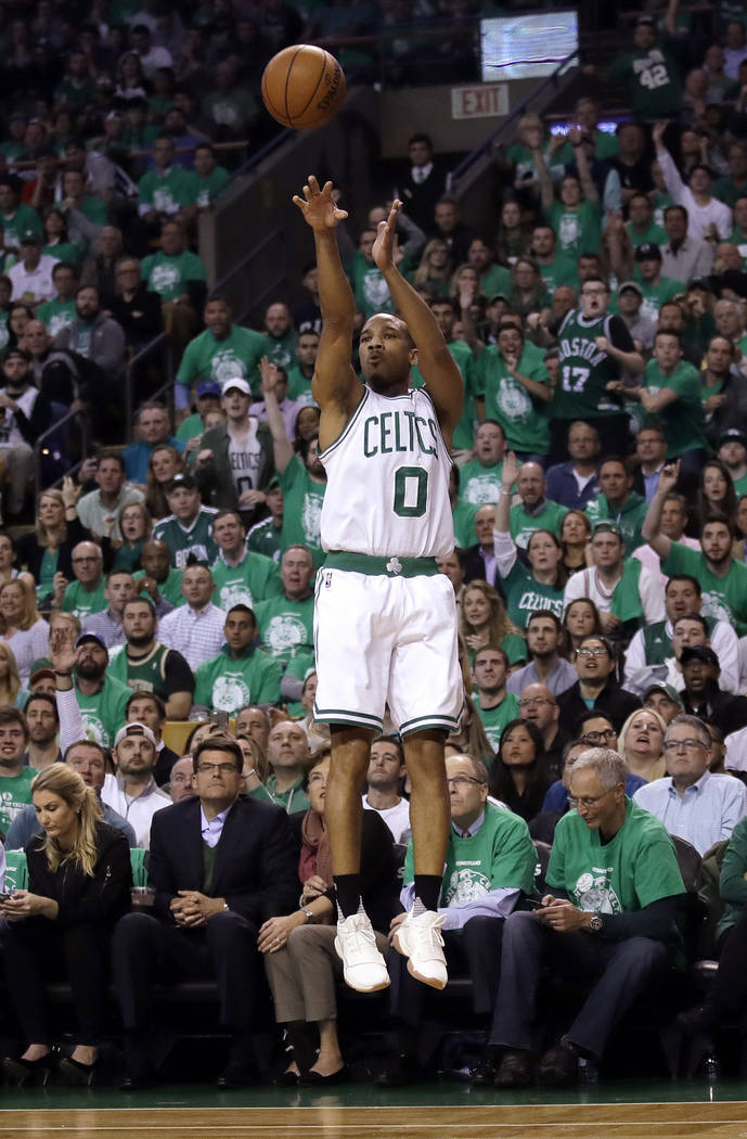 Boston Celtics guard Avery Bradley launches a three point shot during the first quarter of Game 7 of a second-round NBA basketball playoff series against the Washington Wizards, Monday, May 15, 20 ...
