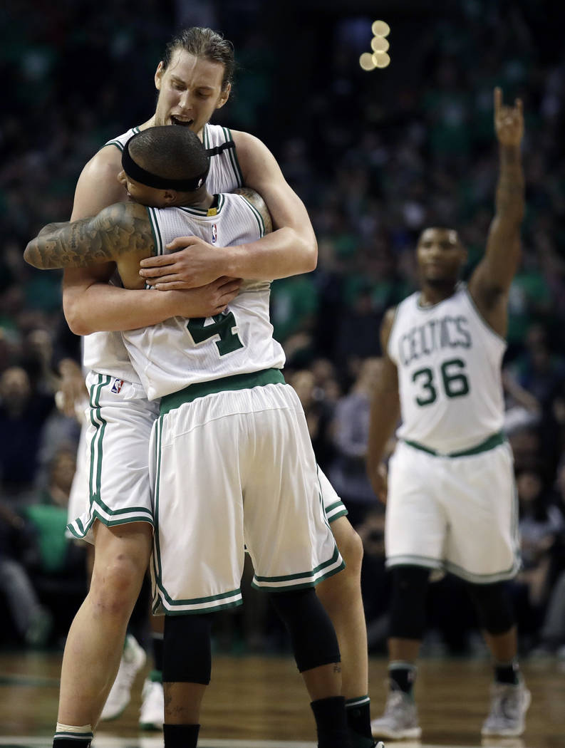 Boston Celtics guards Isaiah Thomas (4) and Marcus Smart (36) celebrate with center Kelly Olynyk (41) after Olynyk sank a basket during the fourth quarter of Game 7 of a second-round NBA basketbal ...