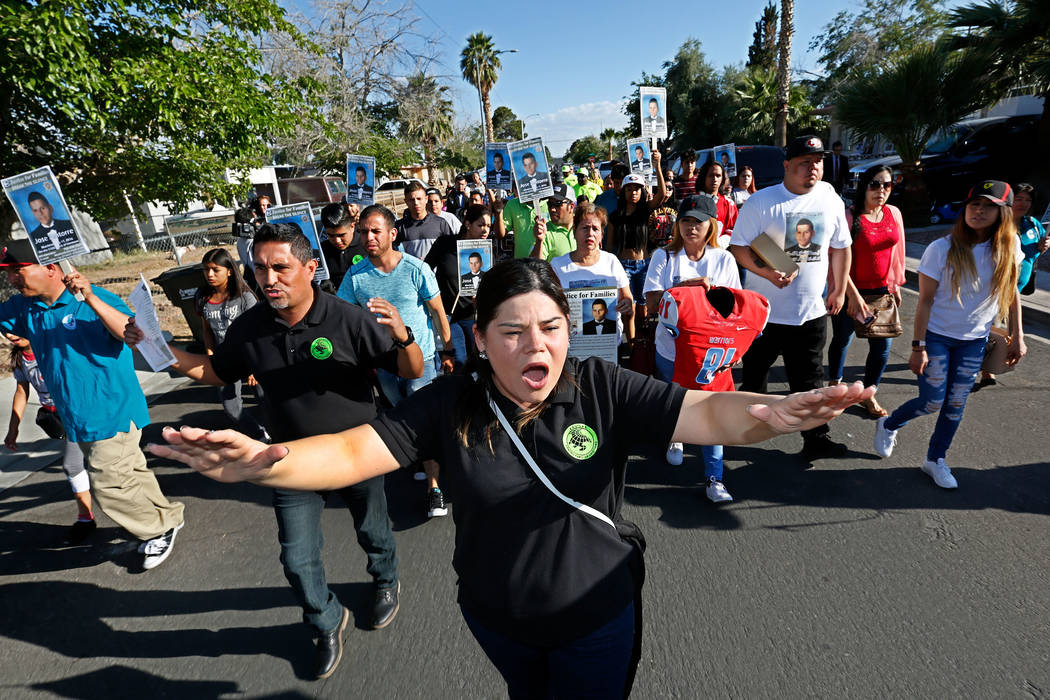 Erika Sanchez, center, marches with other community members in Las Vegas, Monday, May 15, 2017, during a vigil to remember a slain teen, Jose De Jesus Alatorre Guzman.  Alatorre Guzman was murdere ...