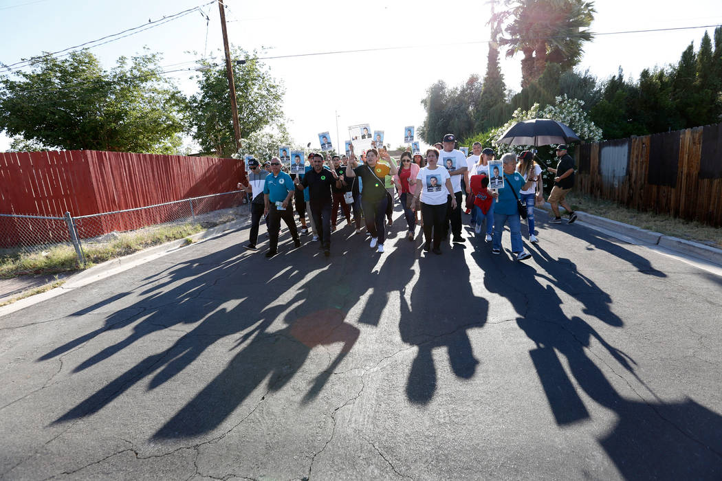 Community members march in Las Vegas, Monday, May 15, 2017, during a vigil to remember a slain teen, Jose De Jesus Alatorre Guzman.  Alatorre Guzman was murdered on May 11, 2016 and the police hav ...