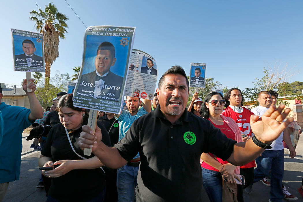 Pastor Luis Snchez, center, marches with other community members in Las Vegas, Monday, May 15, 2017, during a vigil to remember a slain teen, Jose De Jesus Alatorre Guzman.  Alatorre Guzman was mu ...