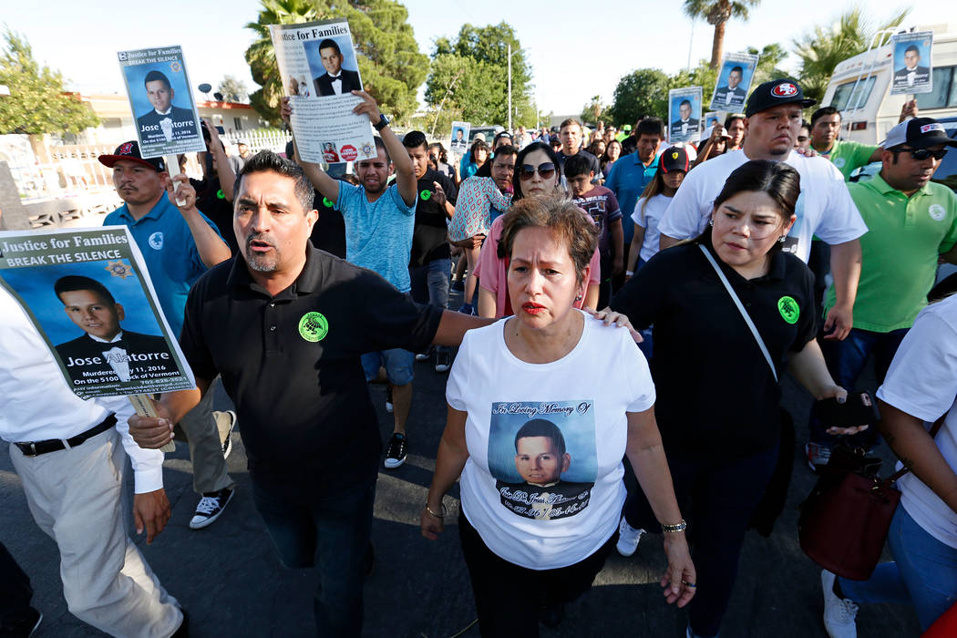Edith Guzman, center, marches with community members including Pastor Luis Sanchez, left, and Erika Sanchez, right, in Las Vegas, Monday, May 15, 2017, during a vigil to remember her son Jose De J ...