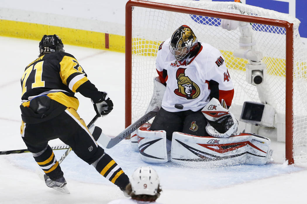 Ottawa Senators goalie Craig Anderson (41) stops a shot by Pittsburgh Penguins' Evgeni Malkin (71) during the first period of Game 2 of the Eastern Conference final in the NHL hockey Stanley Cup p ...