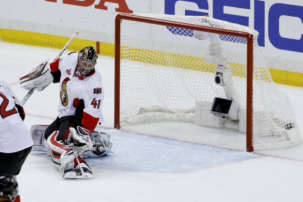 A shot by Pittsburgh Penguins' Phil Kessel gets past Ottawa Senators goalie Craig Anderson during the third period of Game 2 of the Eastern Conference final in the NHL hockey Stanley Cup playoffs, ...