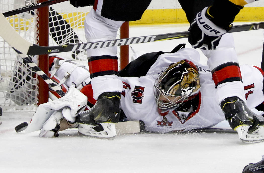 Ottawa Senators goalie Craig Anderson (41) knocks the puck out of the crease against the Pittsburgh Penguins during the second period of Game 2 of the Eastern Conference final in the NHL hockey St ...