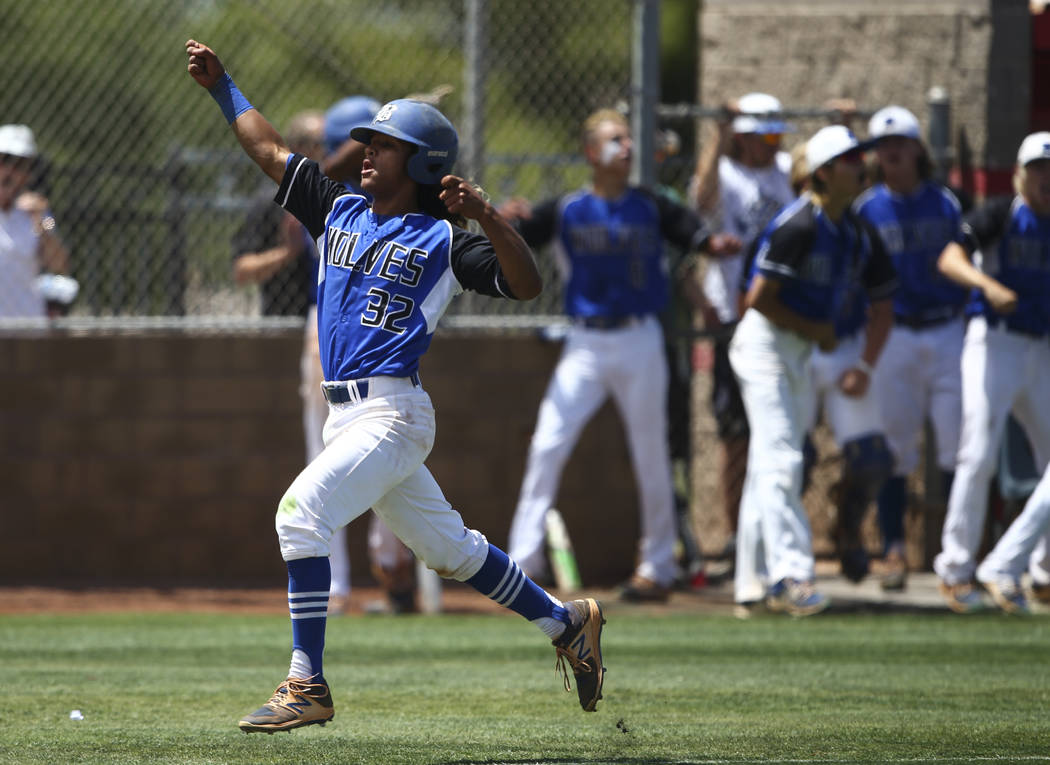 Basic's Christian Rivero (32) reacts on his way to score a run against Galena during a Class 4A state baseball tournament game at Las Vegas High School in Las Vegas on Thursday, May 18, 2017. Basi ...