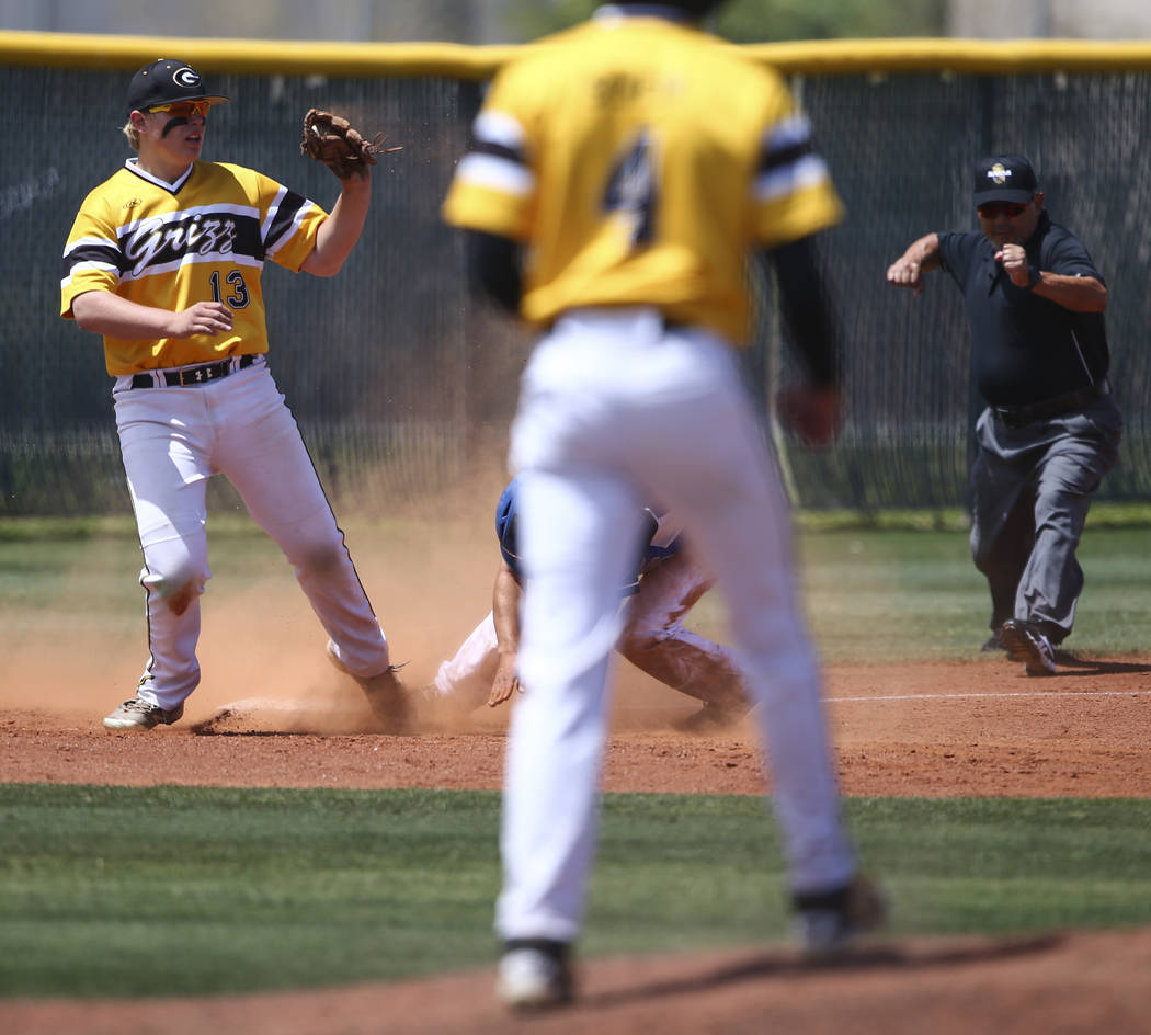 Galena's Nick Myers (13) tags out Basic's Nick Thompson during a Class 4A state baseball tournament game at Las Vegas High School in Las Vegas on Thursday, May 18, 2017. Basic won 12-0. Chase Stev ...