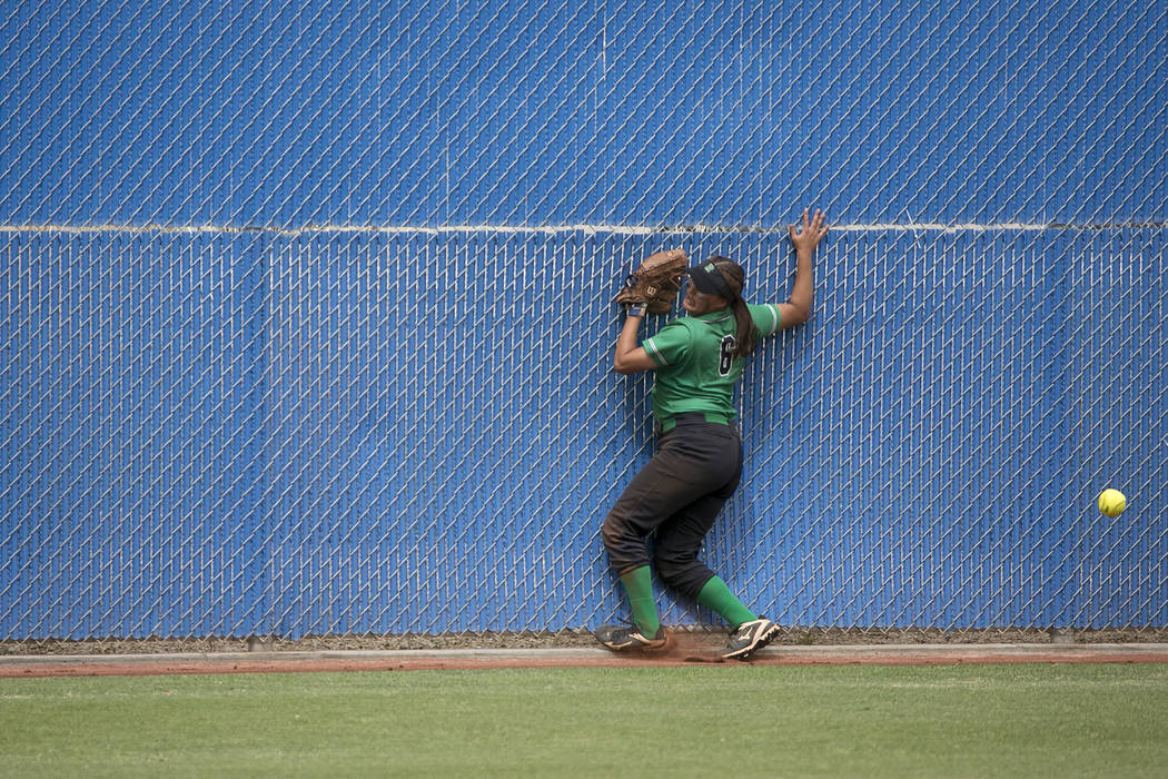 Rancho sophomore Lili Gutierrez (6) attempts to catch the ball in the outfield but misses during a game against Palo Verde at Bishop Gorman High School in part of the Class 4A state softball tourn ...